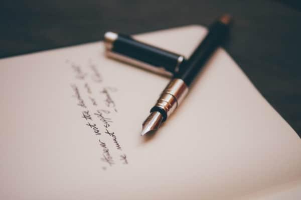 Sfeerbeeld pen en papier voor Zienswijze Vog